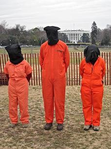 Three campaigners for the closure of Guantánamo outside the White House.